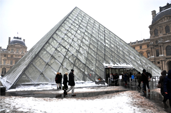 The iconic glass pyramid at the Louvre Museum in Paris. © Dipankar Paul/FoloMojo