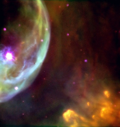 This NASA/ESA Hubble Space Telescope image reveals an expanding shell of glowing gas surrounding a hot, massive star in our Milky Way Galaxy. The shell is being shaped by strong stellar winds of material and radiation produced by the bright star at the left, which is 10 to 20 times more massive than our Sun.  Image courtesy: Hubble hertigae team